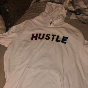 "rainbow lettering on white sweatshirt ""HUSTLE"""